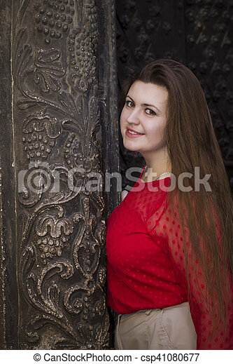 Beautiful woman near the old building in Lviv - csp41080677