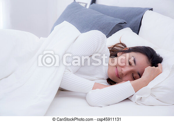Beautiful woman on bed sleeping at home in the bedroom. - csp45911131