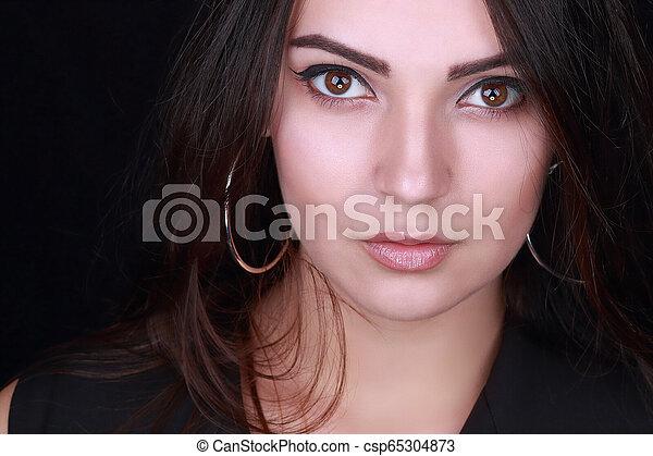 beautiful woman on black background - csp65304873