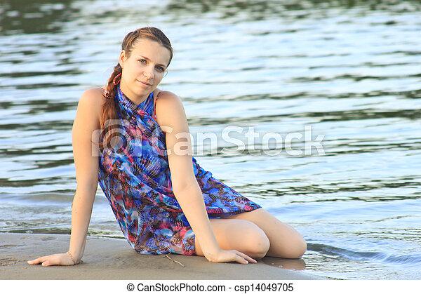 Beautiful woman on the bank - csp14049705