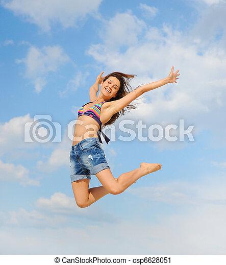 Beautiful Woman over blue Sky - csp6628051