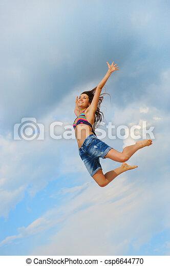 Beautiful Woman over blue Sky - csp6644770