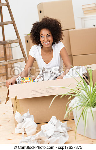 Beautiful woman packing to move house - csp17627375