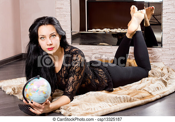 Beautiful woman planning a trip - csp13325187
