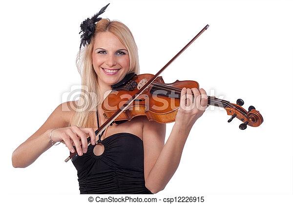 Beautiful woman playing violin - csp12226915