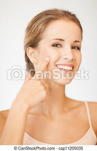 beautiful woman pointing to cheek - csp11205035