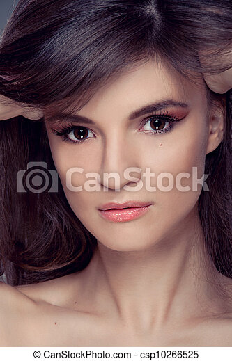 Beautiful woman portrait with Makeup and Healthy brown Hair - csp10266525