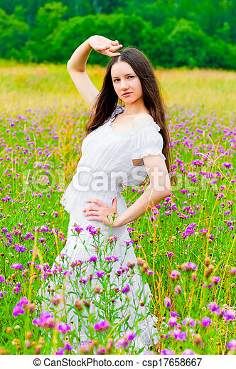 beautiful woman posing in a field with flowers - csp17658667
