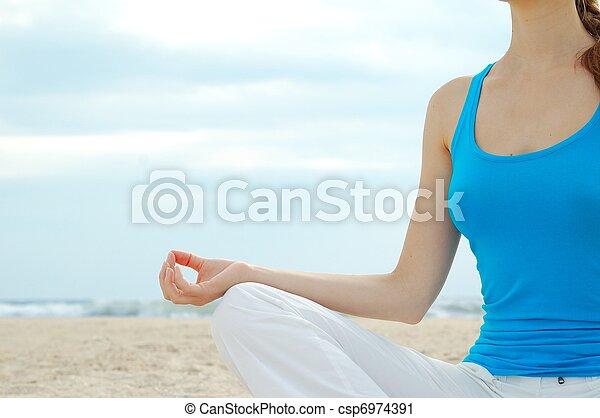 Beautiful woman practice yoga on the beach - csp6974391