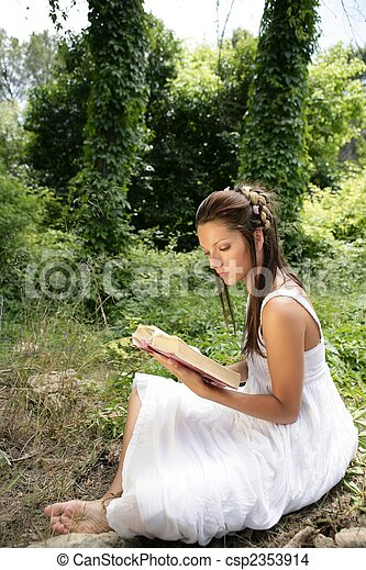 Beautiful woman reading a book in forest, nature - csp2353914