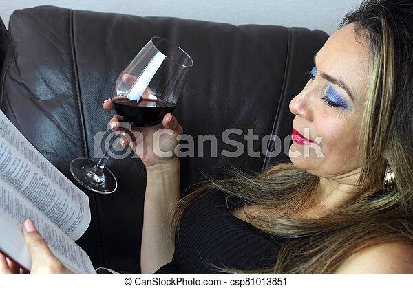 Beautiful woman reading a book - csp81013851