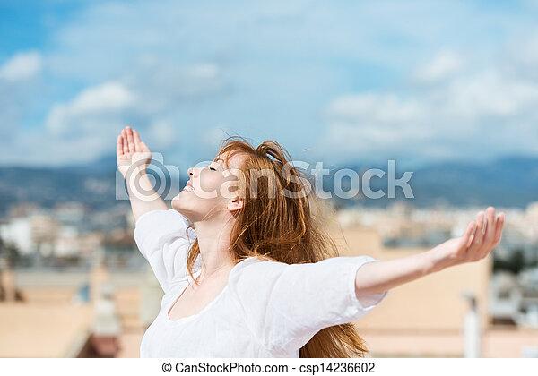 Beautiful woman rejoicing in the sunshine - csp14236602