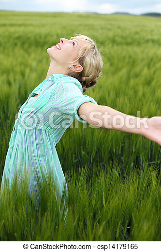 Beautiful woman rejoicing in the summer - csp14179165