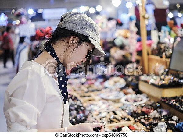 Beautiful woman shopping in festival - csp54869756