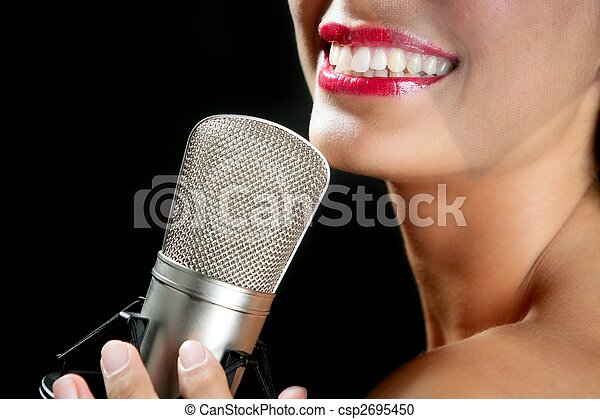 Beautiful woman singing on a vintage microphone - csp2695450