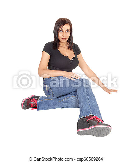 Beautiful woman sitting on the floor - csp60569264
