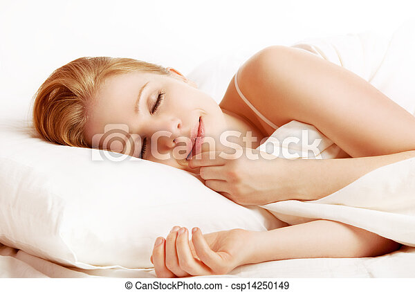 beautiful woman sleeping and smiles in his sleep in  bed  - csp14250149
