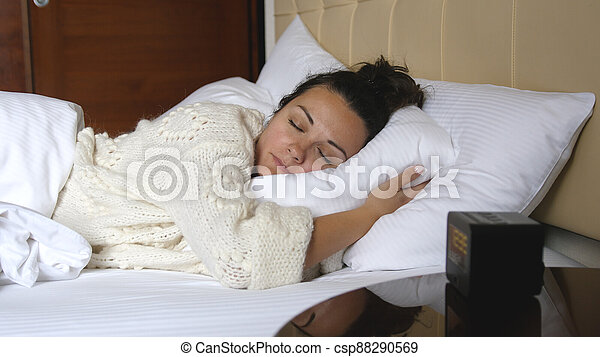Beautiful woman sleeps in bed at home - csp88290569