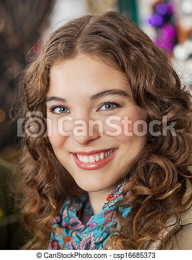 Beautiful Woman Smiling In Christmas Store - csp16685373