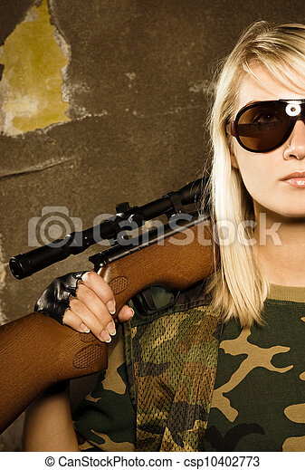 Beautiful woman soldier with a sniper rifle - csp10402773