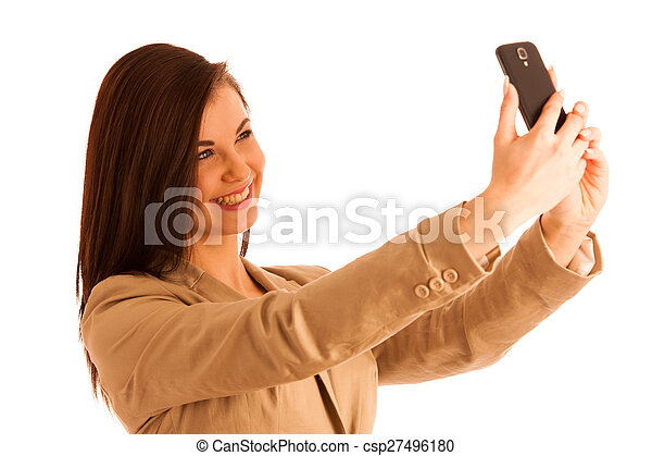Beautiful woman taking a selfie with smartphone on white background - csp27496180