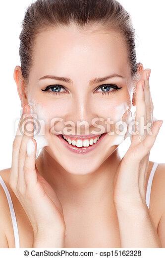 Beautiful woman washing her face  - csp15162328