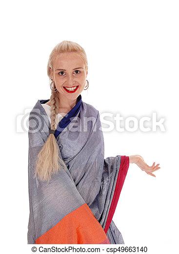 Beautiful woman wearing an east Indian dress - csp49663140