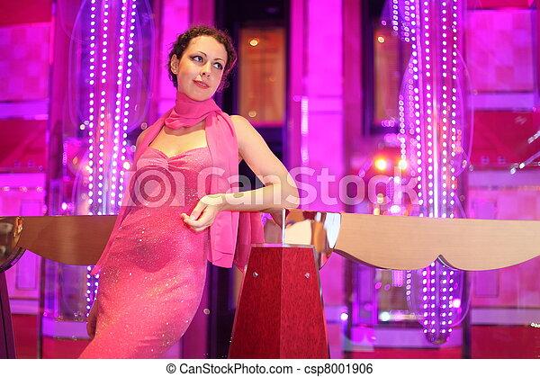 beautiful woman wearing evening dress standing in illuminated hall. - csp8001906