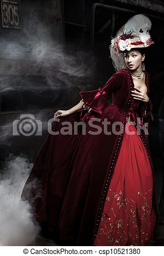 Beautiful woman wearing red dress over a train - csp10521380
