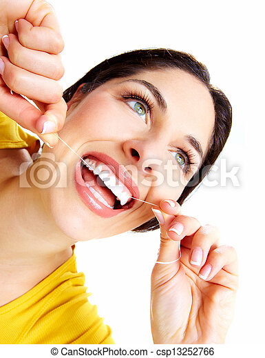 Beautiful woman with a dental floss. - csp13252766