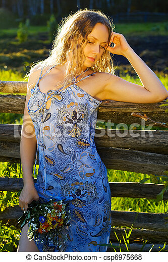 Beautiful woman with a flowers - csp6975668
