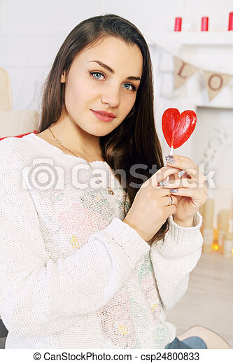 beautiful woman with a lollipop - csp24800833