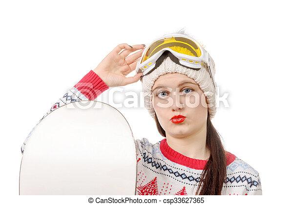 beautiful woman with a snowboard in studio - csp33627365