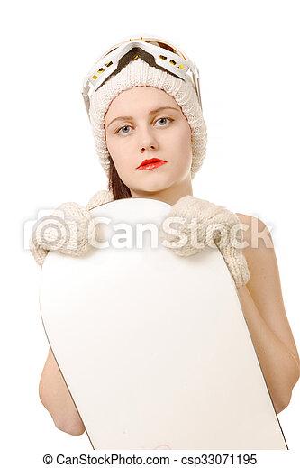 beautiful woman with a snowboard in studio  - csp33071195
