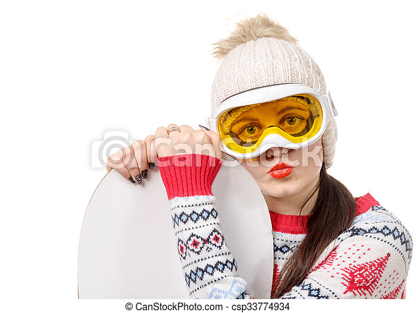 beautiful woman with a snowboard in studio - csp33774934