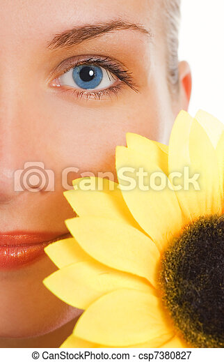 Beautiful woman with a sunflower - csp7380827
