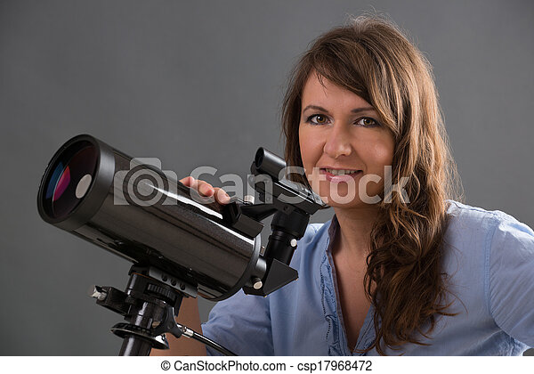 Beautiful woman with astronomical telescope - csp17968472