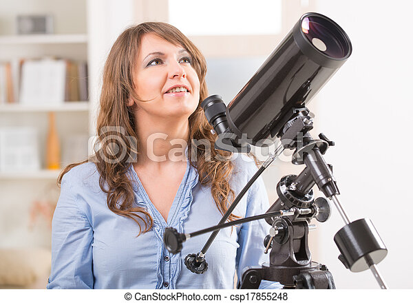 Beautiful woman with astronomical telescope - csp17855248