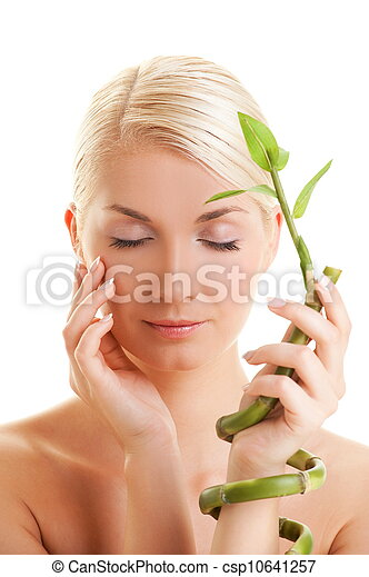 Beautiful woman with bamboo plant - csp10641257