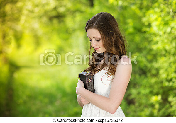Beautiful woman with Bible - csp15736072