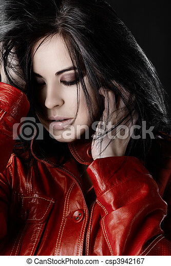 Beautiful woman with black hair in red leather jacket - csp3942167