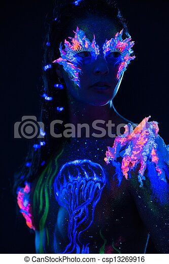Beautiful woman with body art glowing in ultraviolet light - csp13269916