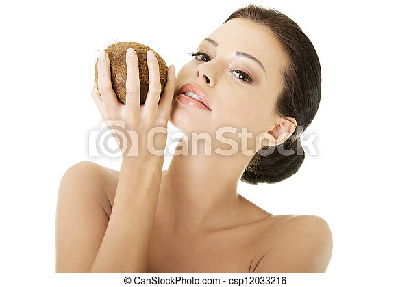 Beautiful woman with coconut in hands - csp12033216