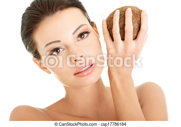 Beautiful woman with coconut in hands - csp17786184