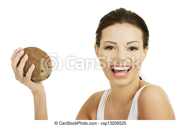 Beautiful woman with coconut in hands - csp13206525