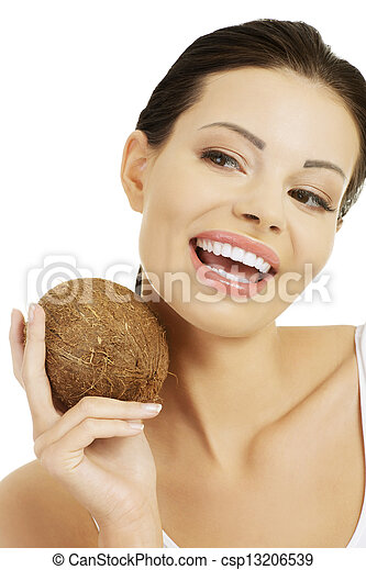 Beautiful woman with coconut in hands - csp13206539