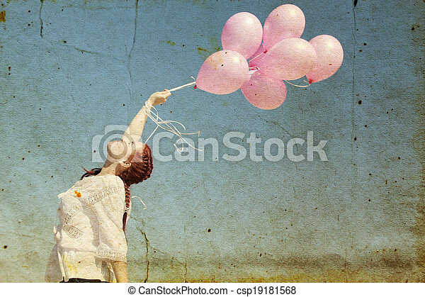 beautiful woman with colorful balloons outside. Photo in old image style. - csp19181568