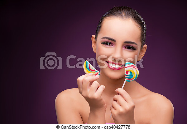 Beautiful woman with colourful lollipop - csp40427778