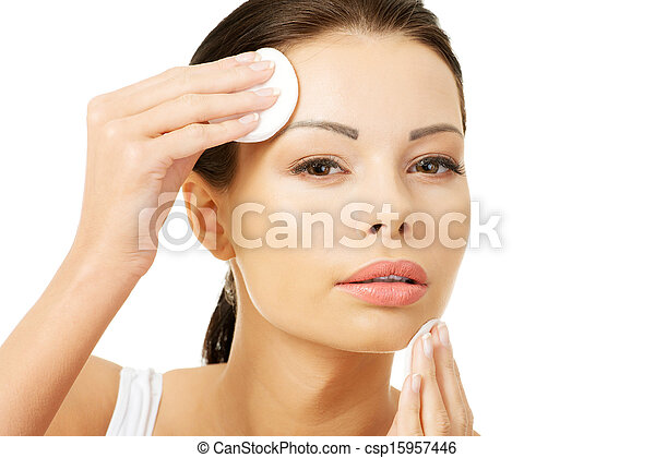 Beautiful woman with cotton pad - csp15957446