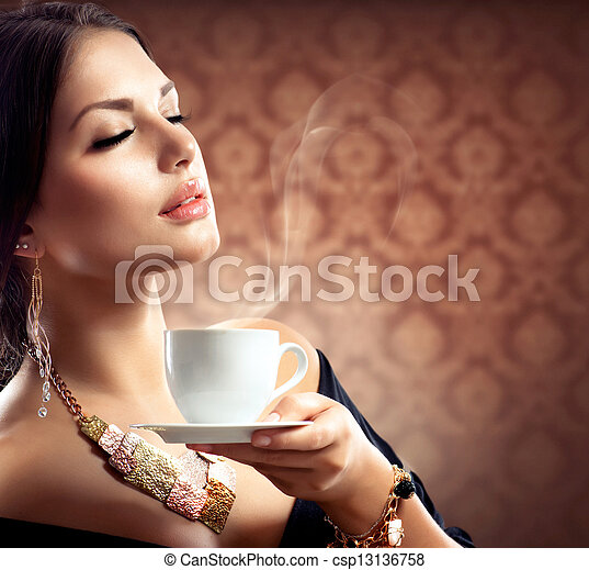 Beautiful Woman With Cup of Coffee or Tea - csp13136758